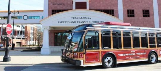Brilliant red Tuscaloosa Trolleys, like the one shown above, have stops on the McKenzie Court route at both the east and main entrance to Stillman's campus, across Stillman Boulevard. Crosswalks, transit signs and benches at the stop provide convenience. Photo courtesy of Jesse White Jr.