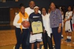 Angel Mitchell, second from left, acknowledges an award given to her on senior night. Women's Head Basketball Coach Cassandra Moorer; Alvin Mitchell, Angel's father; Carmen Mitchell, Angel's mother and sister Alicia Mitchell pose for a portrait. Submitted photo.