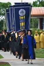 Graduates at Stillman College walking to the graduation ceremony. Photo released by Google Images