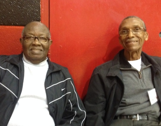 (From left) James Cunningham, former coach and sports director of the Benjamin Barnes YMCA, and Jim Holland, former Central High School girls basketball coach, visit during the Barnes youth basketball league games in January. The two friends visit the Barnes Y often. Photo by Lucinda Coulter